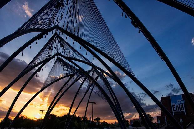 "Enid artist Romy Owens' large-scale public artwork ""Under Her Wing Was the Universe"" is seen at sunset. [Tanya Mattek photo]"