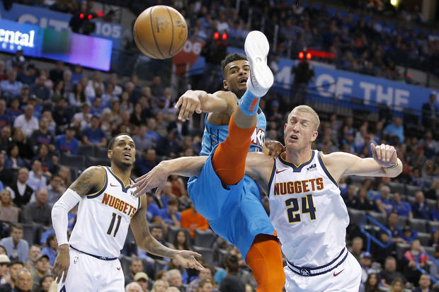 Oklahoma City's Timothe Luwawu Cabarrot loses the ball between Denver's Mason Plumlee and Monte Morris after attempting a dunk during an NBA basketball game between the Oklahoma City Thunder and the Denver Nuggets at Chesapeake Energ