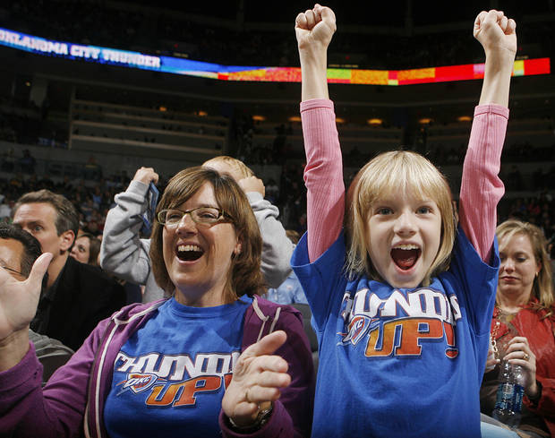 photo - Anne Seys and her daughter Amelia cheer on the Thunder during the preseason NBA basketball game between the Oklahoma City Thunder and the Phoenix Suns at the Ford Center on Monday, Oct. 12, 2009, in Oklahoma City, Okla. Photo by Chris Landsberger, The Oklahoman.