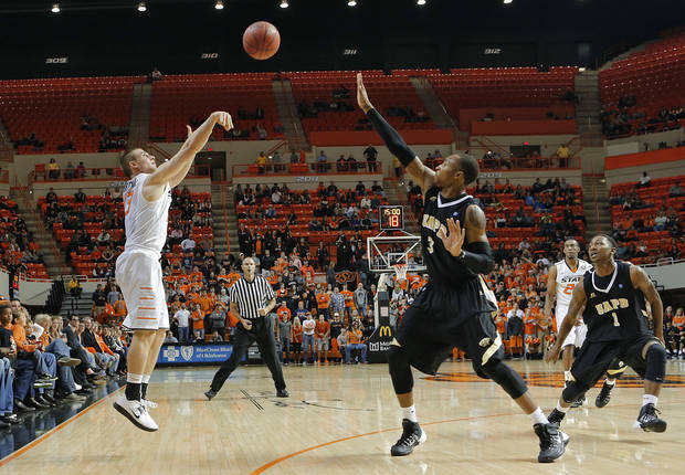 photo - Oklahoma State's Phil Forte shoots a 3-pointer over Arkansas-Pine Bluff's DaVon Haynes during the Cowboys' 97-63 victory Friday night at Gallagher Iba Arena. Photo by Chris Landsberger, The Oklahoman