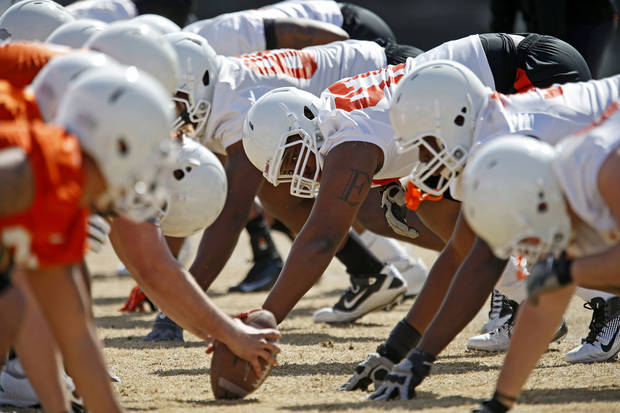 photo - OKLAHOMA STATE UNIVERSITY / OSU / COLLEGE FOOTBALL: Oklahoma State's Eric Davis lines up during an OSU spring football practice in Stillwater, Okla., Wednesday, March 13, 2013. Photo by Bryan Terry, The Oklahoman