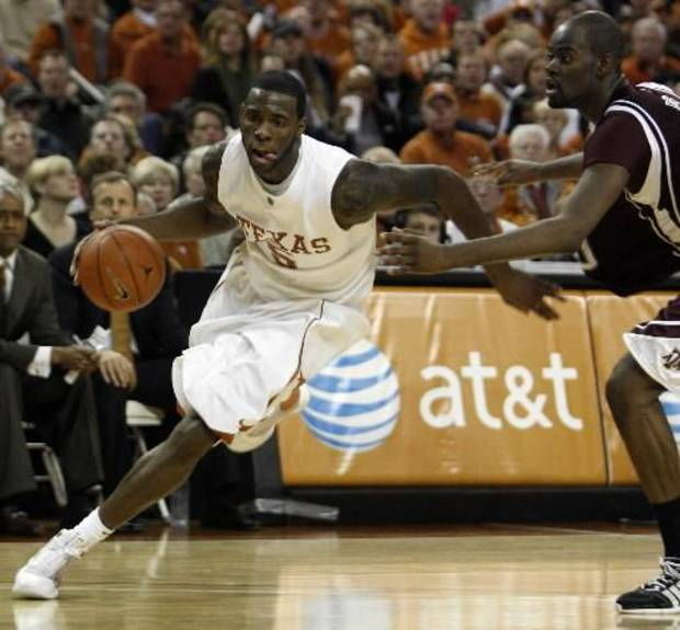 photo - Texas'  Damion  James, left, moves around Texas A&M's Bryan Davis during their NCAA college basketball game in Austin, Texas, on Saturday, Jan. 24, 2009. Texas defeated Texas A&M 67-58.  James scored 28 points.(AP Photo/Deborah Cannon)