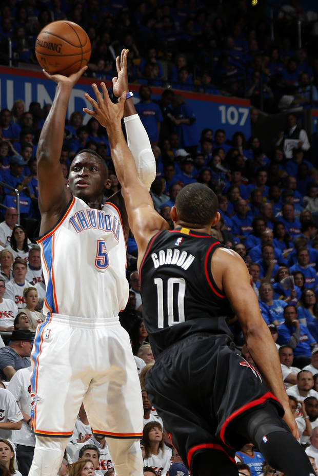 Oklahoma City's Victor Oladipo (5) shoots over Houston's Eric Gordon (10) during Game 3 in the first round of the NBA basketball playoffs between the Oklahoma City Thunder and the Houston Rockets at Chesapeake Energy Arena in Oklahoma City, Friday, April 21, 2017.  Photo by Nate Billings, The Oklahoman