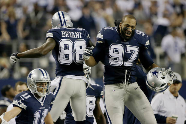 photo - Dallas Cowboys wide receiver Dez Bryant (88) celebrates his touchdown against the Oakland Raiders with Jason Hatcher (97) during the second half of an NFL football game, Thursday, Nov. 28, 2013, in Arlington, Texas.  (AP Photo/Tim Sharp)