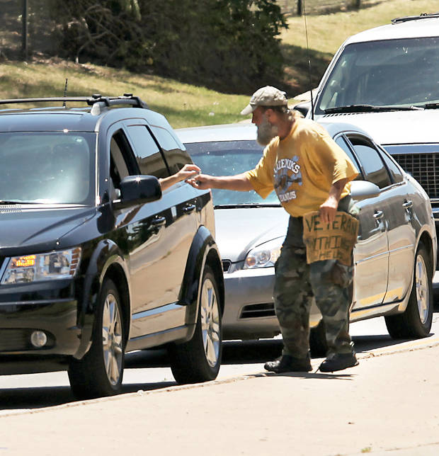 The city council will decide later whether to ask the U,S. Supreme Court to rule on a panhandling ordinance. This photo is from August 2010 on the northbound I-235 exit ramp at N 23rd street in Oklahoma City. [Photo by John Clanton, The Oklahoman]