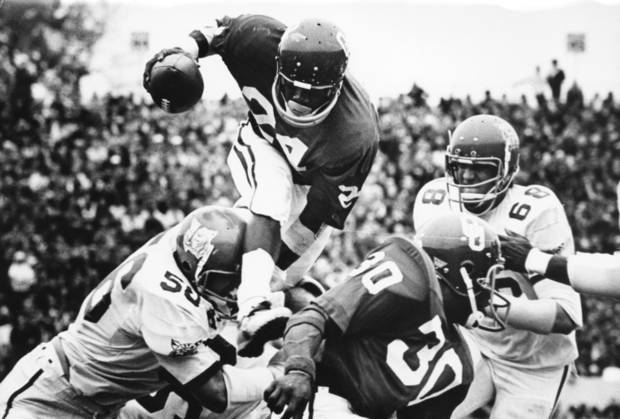 photo - Sooner freshman Joe Washington leaps over a Kansas State player during a Oct. 28, 1972, game. Providing a block is teammate Greg Pruitt (30).  The Sooners beat the Wildcats 52-0. PHOTO BY JIM ARGO, THE OKLAHOMAN ARCHIVES