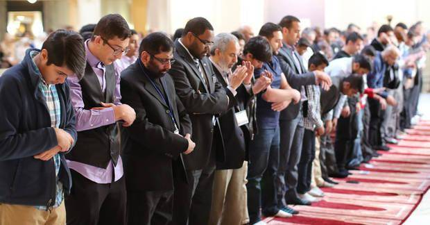 "Men pray at the third annual ""Muslim Day at the Capitol"" in Oklahoma City in March 2017. [Photo by Doug Hoke, The Oklahoman]"