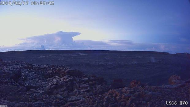 This photo provided by U.S. Geological Survey shows the ash plume at the KÄ«lauea Volcano, taken from a Mauna Loa webcam on Thursday, May 17, 2018 in Hawaii. The volcano has erupted from its summit, shooting a dusty plume of ash about 30,000 feet into the sky. Mike Poland, a geophysicist with the U.S. Geological Survey, confirmed the explosion on Thursday. It comes after more than a dozen fissures recently opened miles to the east of the crater and spewed lava into neighborhoods. (U.S. Geological Survey/HVO via AP)