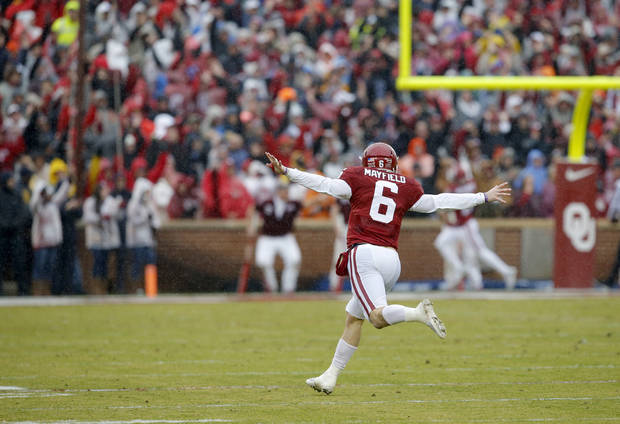 Oklahoma's Baker Mayfield (6) celebrates after throwing a touchdown pass during the Bedlam college football game between the Oklahoma Sooners (OU) and the Oklahoma State Cowboys (OSU) at Gaylord Family - Oklahoma Memorial Stadium in Norman, Okla., Saturday, Dec. 3, 2016. Oklahoma won 38-20. Photo by Bryan Terry, The Oklahoman
