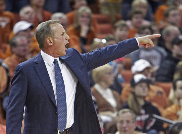 photo - Texas coach Rick Barnes calls out to his team during the second half of an NCAA college basketball game against Oklahoma, Saturday, Jan. 4, 2014, in Austin, Texas. Oklahoma won 88-85. (AP Photo/Michael Thomas)