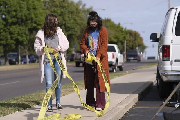 "Two crew members wrangle crime scene tape on the set of the Oklahoma film ""Out of Exile"" at the Flamingo Apartments on NW 23 St. Thursday, October 15, 2020. [Doug Hoke/The Oklahoman]"