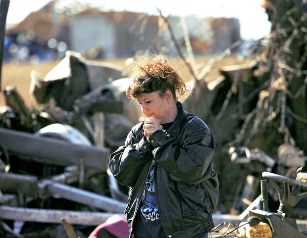 photo - Neda Wilson reacts as she looks at her sister's destroyed home Wednesday in Lone Grove.  Photo by John Clanton, The Oklahoman