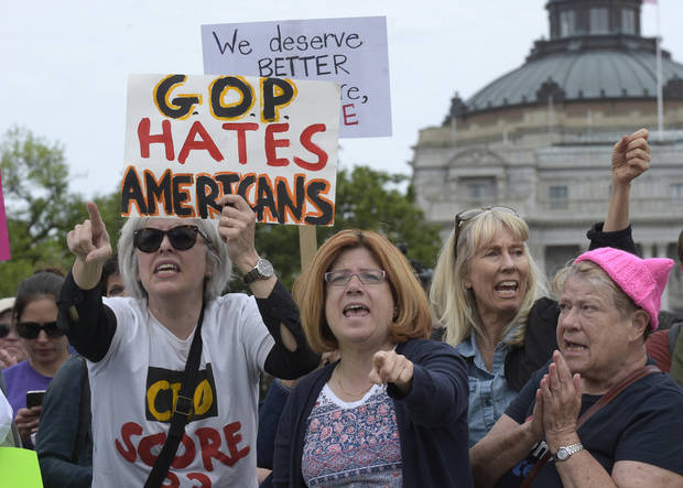 Protesters chant as Republican and Democratic House members walk down the steps of the Capitol in Washington, Thursday, May 4, 2017, after the Republican health care bill passed in the House. (AP Photo/Susan Walsh)
