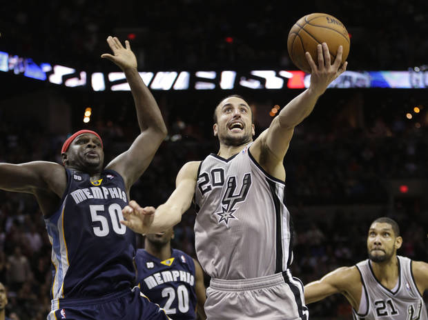 photo - San Antonio Spurs' Manu Ginobili (20), of Argentina, drives to the basket past Memphis Grizzlies defender Zach Randolph (50) during the fourth quarter of an NBA basketball game, Saturday, Dec. 1, 2012, in San Antonio. San Antonio won 99-95. (AP Photo/Eric Gay) ORG XMIT: TXEG114