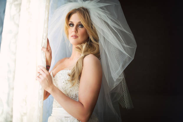 photo - Malorie Gulikers poses during her bridal photo shoot. Photo by Traina Photography. <strong></strong>