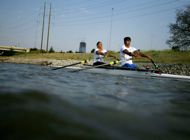 photo - Paralympic rower Tony Davis, practices with rowing partner Jacqui Kapinowski on the Oklahoma River in Oklahoma City on Tuesday, June 14, 2011. A car accident left Davis, a former Navy Rescue Diver, paralyzed. He taught himself to walk with difficulty, and has been rowing for two years. Photo by John Clanton, The Oklahoman 