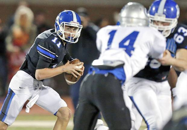 photo - Deer Creek's Caden Sander rolls out against Guthrie during Friday night's game. Photo by Bryan Terry, The Oklahoman