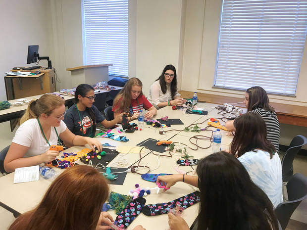 4-H members make crazy sock puppets at State 4-H Roundup this past summer. [PHOTO PROVIDED]