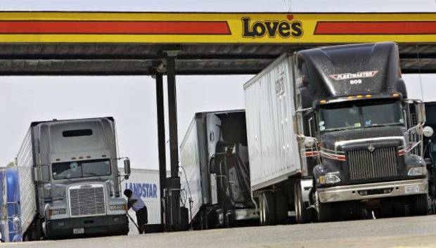 photo - Drivers fuel trucks at a Love's station in Oklahoma City. The Oklahoman Archives