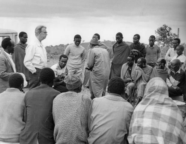 John L. Peters, founder of World Neighbors, talks with Masai tribe members in this photo from 1973. Peters believed everyone should be treated with dignity and respect. He wanted to work side by side with people in impoverished communities to improve their way of life.