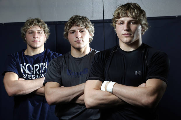 photo - LANCE DIXON / JOEL DIXON / HIGH SCHOOL WRESTLING: From left to right, Edmond North wrestlers , Lance, Joel and Andrew Dixon poses for a picture at Edmond North High School in Edmond, Okla.,  Thursday, Feb. 7, 2013.Photo by Sarah Phipps, The Oklahoman