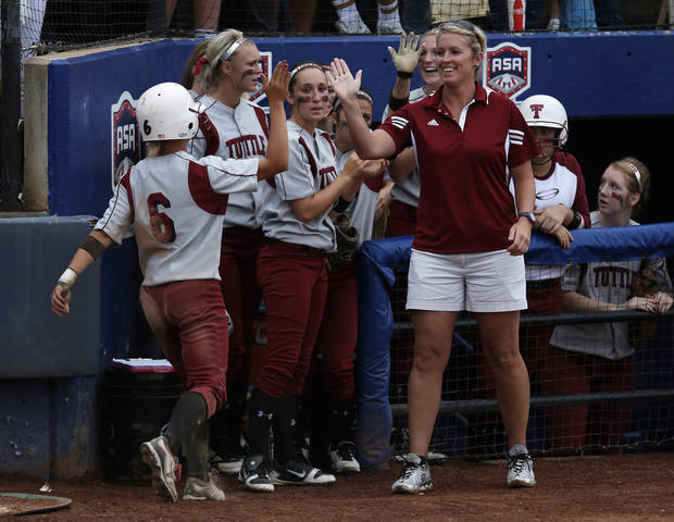 photo - Tuttle's Shelby Carel (6) celebrates with head coach Jenn White after scoring a run during the 4A state softball semifinals game between Oolagah-Talala and Tuttle at ASA Hall of Fame Stadium in Oklahoma City, Okla., Friday, Oct. 12, 2012.  Photo by Garett Fisbeck, The Oklahoman
