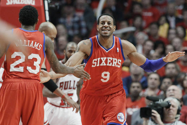 photo - Philadelphia 76ers forward Andre Iguodala (9) smiles as he celebrates with guard Louis Williams (23) after his dunk against the Chicago Bulls during the third quarter of Game 2 in an NBA basketball first-round playoff series, in Chicago on Tuesday, May 1, 2012. (AP Photo/Nam Y. Huh) ORG XMIT: CXA117