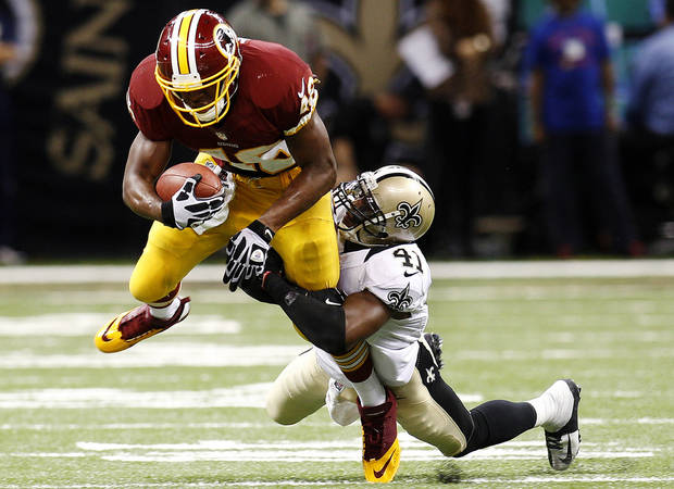 photo - New Orleans Saints strong safety Roman Harper (41) tries to tackle Washington Redskins running back Alfred Morris (46) in the second half of an NFL football game in New Orleans, Sunday, Sept. 9, 2012. (AP Photo/Bill Haber) ORG XMIT: NUA132