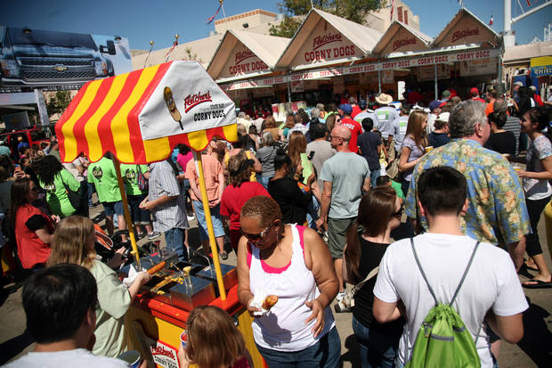 photo - The lines were long at the Fletcher's Corny Dogs stand near Big Tex on opening day of the State Fair of Texas, Friday, Sept. 30, 2011 in Dallas. The State Fair of Texas, which marks its 125th anniversary this year, runs through Oct. 23, 2011. (AP Photo/The Dallas Morning News, Guy Reynolds)