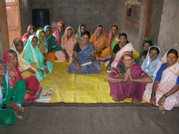 A group of women pose together in India. One of World Neighbors' projects in India involves creating local savings and credit programs for women.