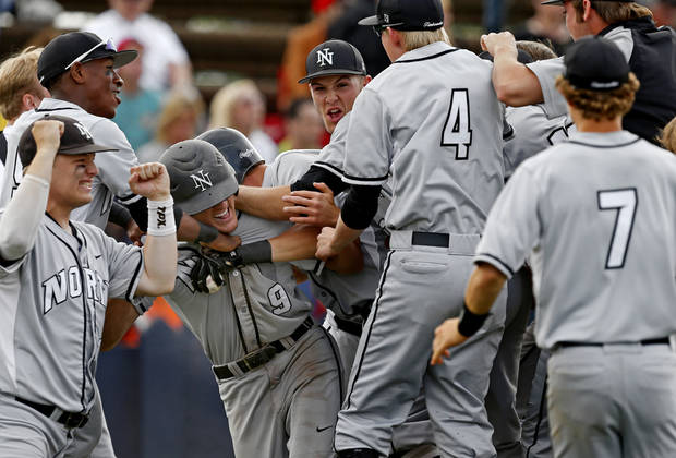 photo - Norman North's Dylan Sterling celebrates with teammates after scoring game-winning run against Yukon during a Class 6A state baseball tournament game in Shawnee, Okla., Friday, May 10, 2013. Photo by Bryan Terry, The Oklahoman