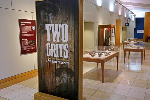 "The National Cowboy & Western Heritage Museum's exhibit ""Two Grits- A Peek Behind the Eyepatch,"" explores the two different films made from the 1968 novel ""True Grit"" by Charles Portis. [Photo by Doug Hoke/The Oklahoman]"