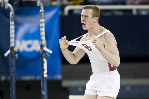 photo - Oklahoma's Alec Robin was second in the vault during the NCAA men's gymnastics championships in Ann Arbor, Mich., on Friday.                    AP Photo