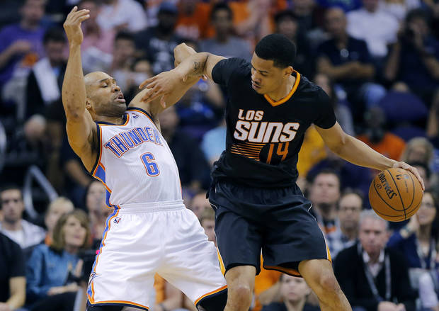 photo - Oklahoma City Thunder guard Derek Fisher (6) is backed down by Phoenix Suns' Gerald Green (14) during the first half of an NBA basketball game, Thursday, March 6, 2014, in Phoenix. (AP Photo/Matt York)