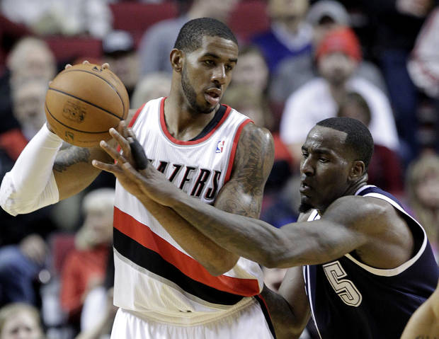 photo - Oklahoma City Thunder center Kendrick Perkins, right, reaches in on Portland Trail Blazers forward LaMarcus Aldridge during the first half of an NBA basketball game in Portland, Ore., Tuesday, Feb. 11, 2014. (AP Photo/Don Ryan)