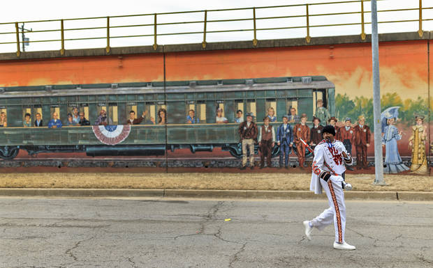 The Douglass High School Drum Major looks back as he leads the band during the annual Oklahoma City Martin Luther King Jr. Holiday Parade in downtown Oklahoma City, Okla. on Monday, Jan. 15, 2018. Photo by Chris Landsberger, The Oklahoman