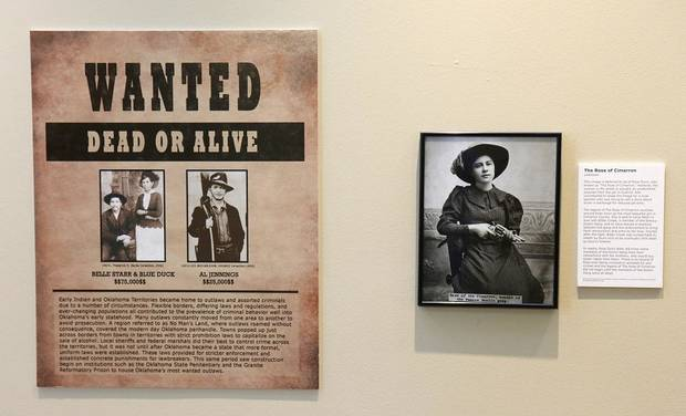 "Wanted posters featuring Belle Star and Blue Duck and Al Jennings are displayed next to The Rose of Cimarron in the Oklahoma History Center's exhibit, ""Wanted: Dead or Alive."" The photography exhibit is comprised of images of some of Oklahoma's most infamous outlaws and lesser-known criminals and will be on display until Feb. 29. [Photo by Doug Hoke/The Oklahoman]"