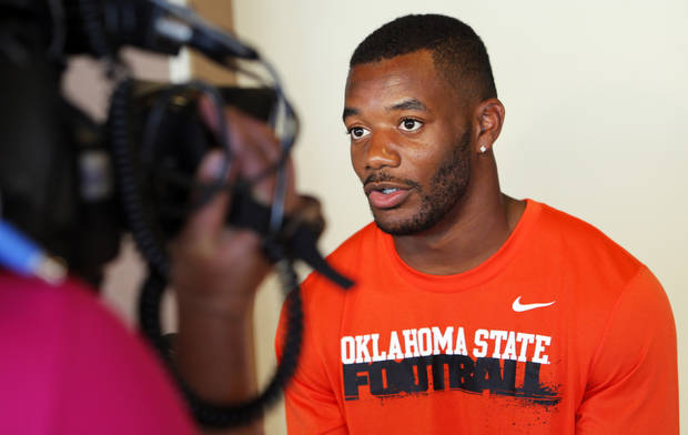 photo - COLLEGE FOOTBALL: OSU's Jeremy Smith gives an interview during Oklahoma State University football media availability at Boone Pickens Stadium in Stillwater, Okla., Thursday, Aug. 23, 2012. Photo by Nate Billings, The Oklahoman
