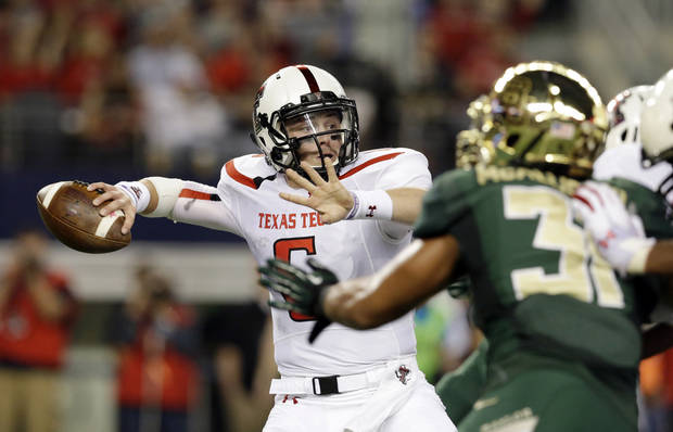photo - Texas Tech quarterback Baker Mayfield, left, passes under pressure from Baylor defensive end Chris McAllister during the first half of an NCAA college football game in Arlington, Texas, Saturday, Nov. 16, 2013. (AP Photo/LM Otero)