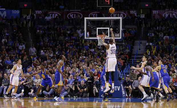 photo - Oklahoma City's Kevin Durant (35) shoots a basket during an NBA basketball game between the Oklahoma City Thunder and the Golden State Warriors at Chesapeake Energy Arena in Oklahoma City, Friday, Jan. 17, 2014. Oklahoma City won 127-121. Photo by Bryan Terry, The Oklahoman