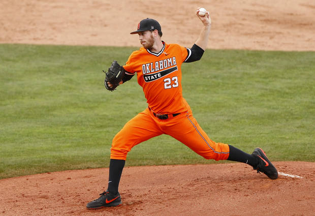 photo - Oklahoma State starting pitcher Michael Freeman delivers in the second inning of the championship game against TCU in the Big 12 conference NCAA college baseball tournament in Oklahoma City, Sunday, May 25, 2014. (AP Photo/Alonzo Adams)