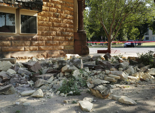 Sandstone bricks from the side of the historic Pawnee County Bank litter the sidewalk at Sixth St. and Harrison in Pawnee, Okla., after an early morning 5.6 magnitude earthquake struck, Saturday, Sept. 3, 2016. Photo by Paul Hellstern, The Oklahoman