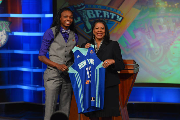 photo - BRISTOL, CT - APRIL 15:  WNBA President Laurel Richie poses with Toni Young after being drafted number seven overall by New York Liberty during the 2013 WNBA Draft Presented By State Farm on April 15, 2013 at ESPN in Bristol, Connecticut.    Photo provided by Jesse D. Garrabrant/NBAE