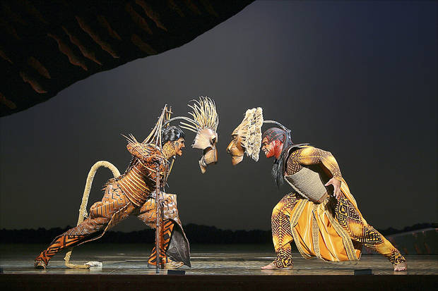 "photo - Timothy Carter and Dionne Randolph perform in a scene from ""The Lion King,"" being staged at Civic Center Music Hall through May 24. PHOTO BY JOAN MARCUS, COPYRIGHT DISNEY"