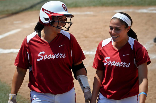photo - Oklahoma infielder Lauren Chamberlain (left) celebrates her home run with outfielder Destinee Martinez (right) in the final game of the seasons Bedlam series held in Stillwater, Okla. on May 12, 2013.  KT King/For the Oklahoman KOD