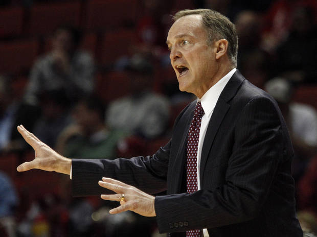 photo - Oklahoma head coach Lon Kruger reacts to an official's call during an NCAA game between Oklahoma and West Virginia at the Lloyd Noble Center in Norman, Okla., Wednesday, March 5, 2014. (AP Photo/Garett Fisbeck)