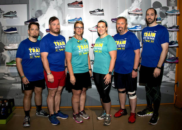 <p>At least six runners training for the Oklahoma City Memorial Marathon with the Oklahoma City running store Red Coyote have lost at least 100 pounds. They are, left to right, Kris Wright, Thomas Griesedieck, Amy Downs, Bettina Horton, Bart Byrns and Andre Anderson. [PHOTO COURTESY OF JAMIE COBB]</p>
