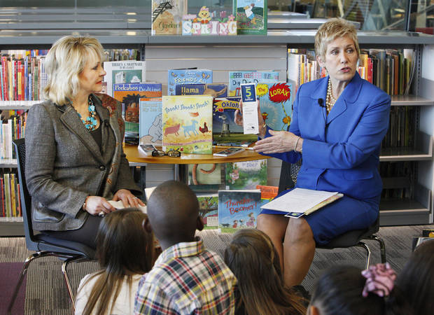 photo - Gov. Mary Fallin looks on as State Superintendent of Public Instruction Janet Barresi shows a bookmark to students from James L. Dennis Elementary School at the Patience S. Latting Northwest Library in Oklahoma City Friday, May 3, 2013. The governor and superintendent were kicking off the State Department of Education's 2013 Summer Reading Program called Read 5 for Summer by reading to the students. Photo by Paul B. Southerland, The Oklahoman