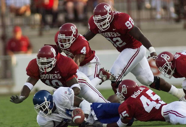 photo - OU vs Indiana State football. OU defense stops Matt Nelson. 10 Torrance Marshall, 4 Pee Wee Woods, 92 Corey Callens, 45 Rodney Rideau
