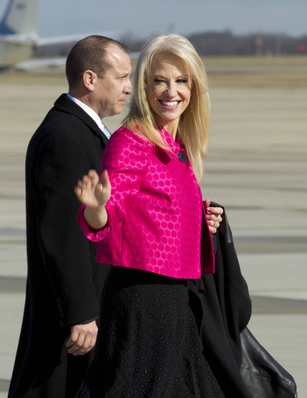 Counselor to President Kellyanne Conway waves to the media before President Donald Trump's arrival at Andrews Air Force One, Md., Thursday, Jan. 26, 2017. Trump is traveling to Philadelphia to speak at the House and Senate GOP lawmakers at their annual policy retreat. ( AP Photo/Jose Luis Magana)